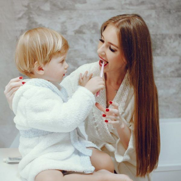 Family in a bathroom. Beautiful mother with little son